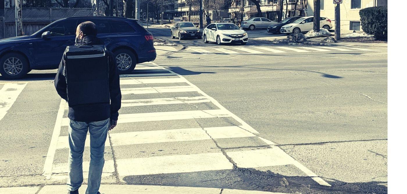Uber Eats walker on street